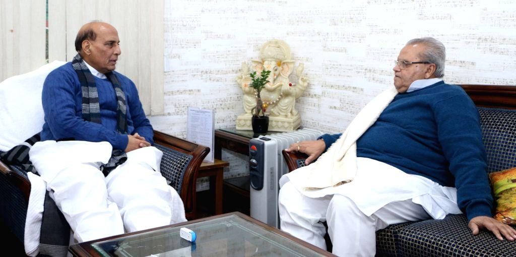 Goa Governor Satya Pal Malik calls on Defence Minister Rajnath Singh, in New Delhi on Jan 10, 2020. - Rajnath Singh and Malik