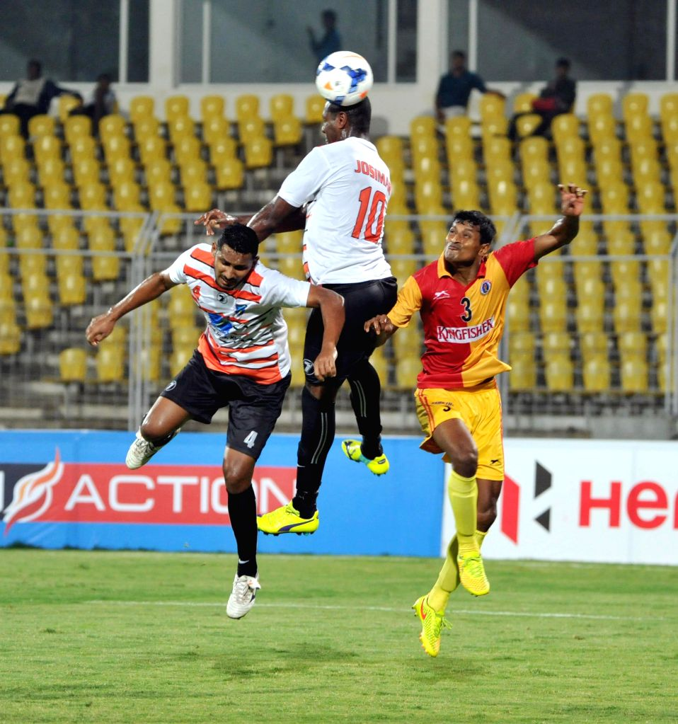 Players in action during a Federation Cup match between Mumbai FC and Mohun Bagan in Goa on Jan 2, 2015.