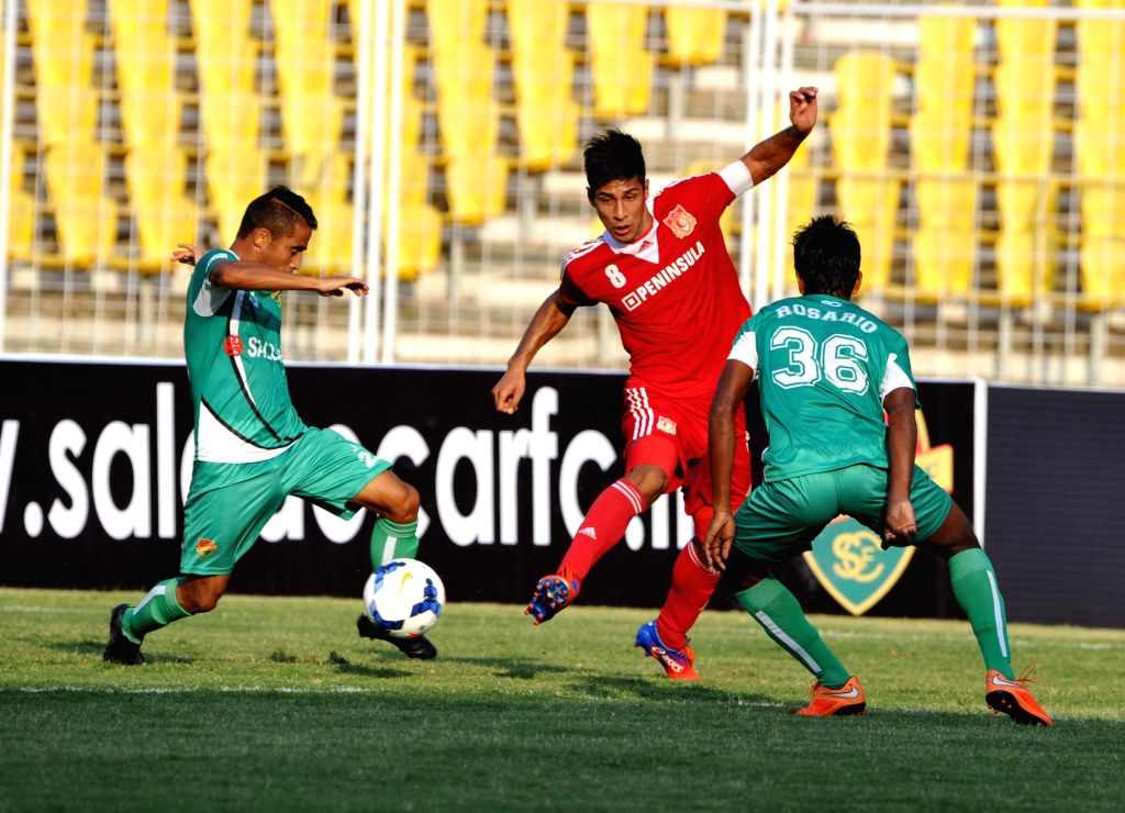 Players of Salgacoar FC & Pune FC in action during the Hero I - League match at Nehru Stadium, Fatorda in Goa on Jan. 17, 2015.
