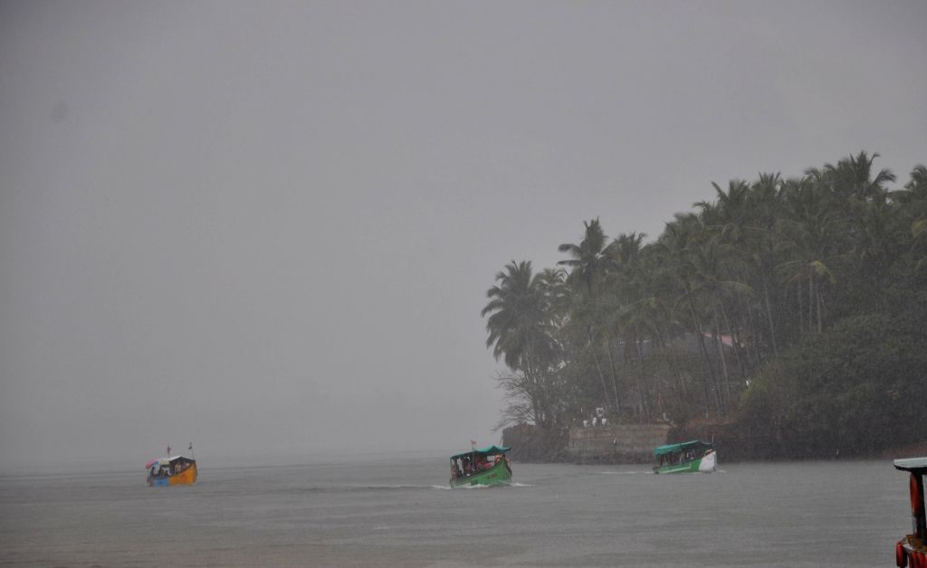 Tourist boats return back to the shore as heavy rains lash Goa on March 1, 2015.