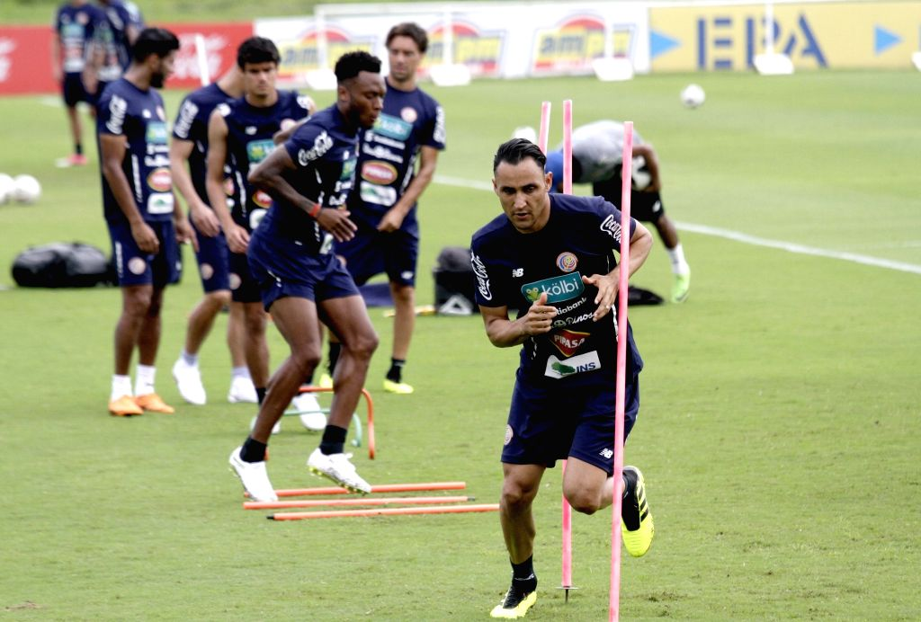 Goalkeeper Keylor Navas (Front) of Costa Rica's national soccer team takes part in a training session in San Antonio de Belen, Costa Rica, on May 30, ...