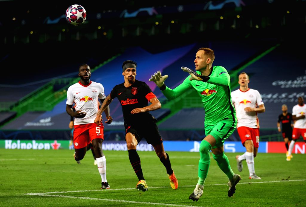 Goalkeeper Peter Gulacsi (3rd L) of RB Leipzig makes a save during the 2019-2020 UEFA Champions League quarter final match between RB Leipzig and Atletico Madrid in ...