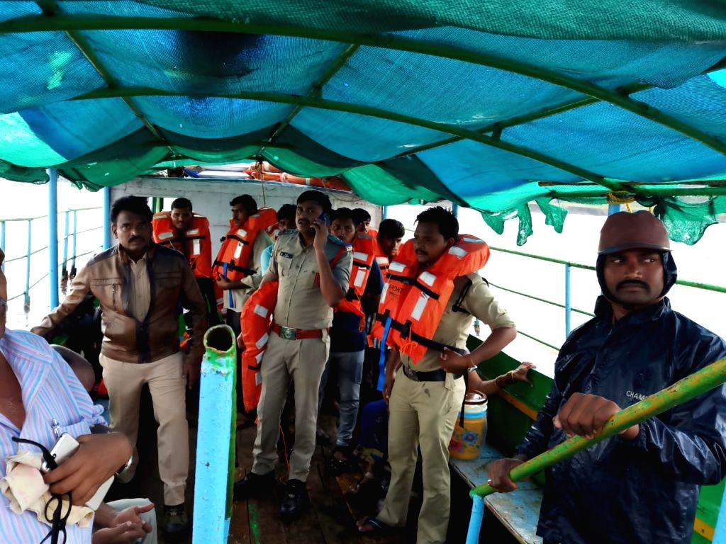 Godavari: Search and rescue operations underway after a boat with about 60 tourists capsized in Godavari river in Andhra Pradesh's East Godavari district on Sep 15, 2019. At least seven persons were killed and many others were missing. (Photo: IANS)