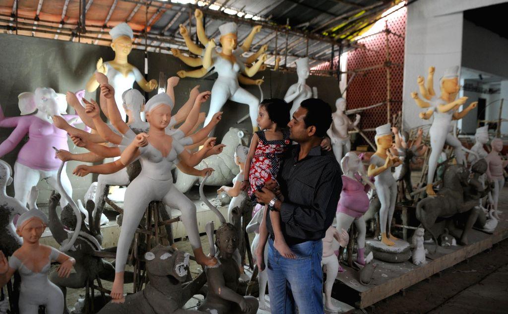 Goddess Durga idols at a workshop ahead of Durga Puja in New Delhi on Sept 19, 2017.