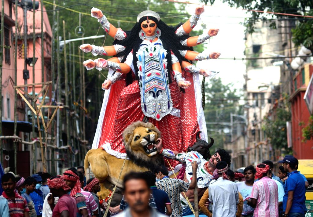 Goddess Durga transported to its worship venue ahead of Durga Puja in Kolkata on Sunday october 03, 2021.