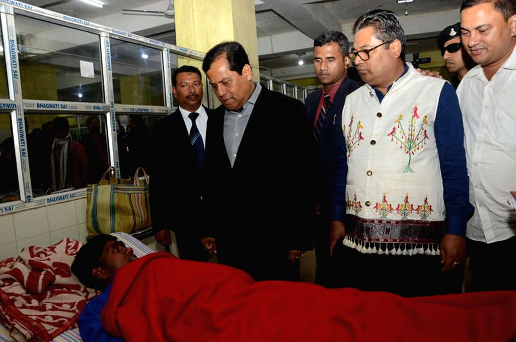 Golaghat: Assam Chief Minister Sarbananda Sonowal interacts with the victims of Assam hooch tragedy at Golaghat Civil Hospital in Assam on Feb 23, 2019. (Photo: IANS) - Sarbananda Sonowal