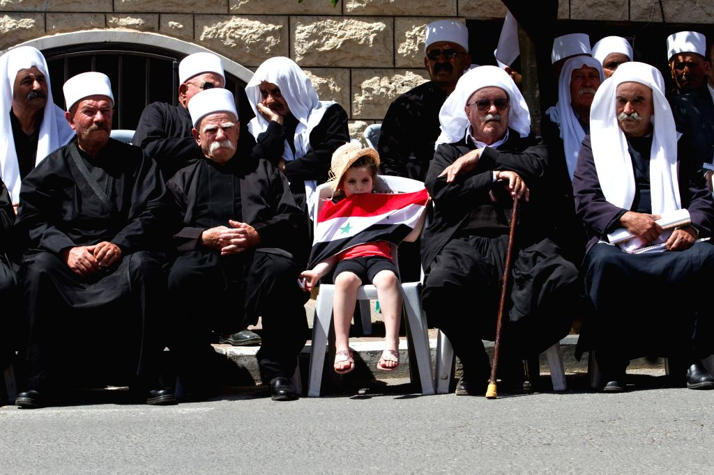 Members of the Druze community attend a rally marking Syria's Independence Day in the Druze village of Majdal Shams on the Golan Heights, on April 17, 2014. .