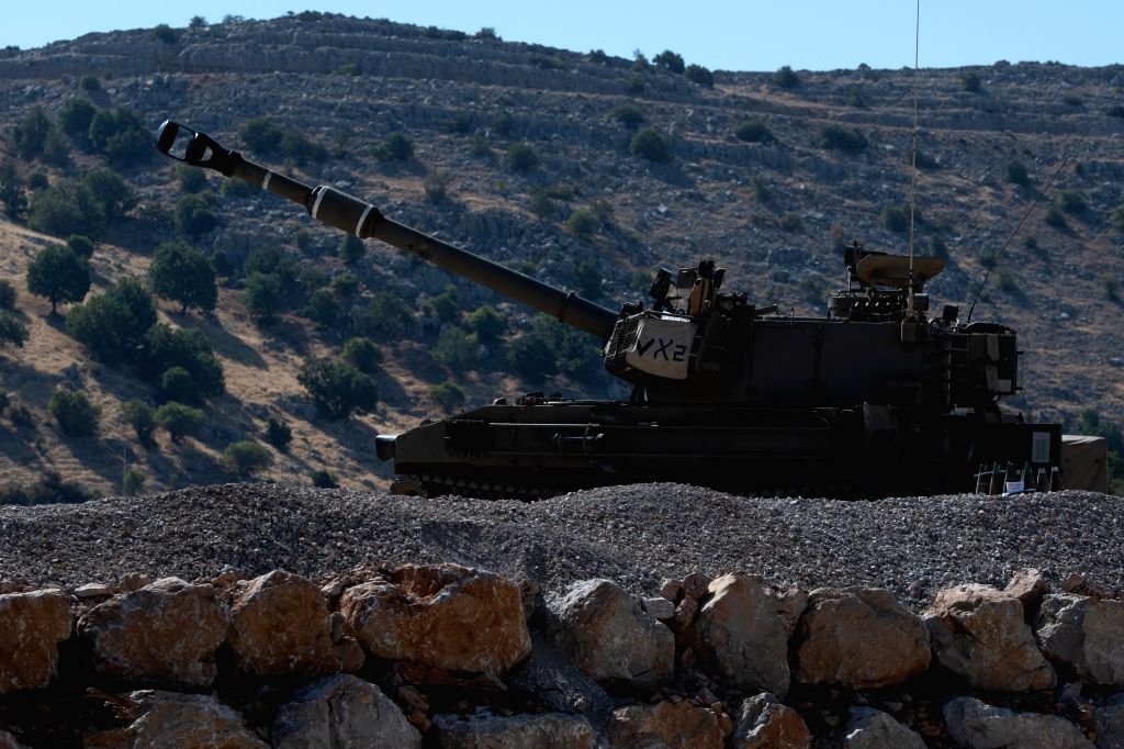 GOLAN HEIGHTS, Aug. 25, 2019 - An armored fighting vehicle is seen in the Israeli occupied Golan Heights, on Aug. 25, 2019. Chief of General Staff of the Israel Defense Forces Aviv Kochavi said on ...