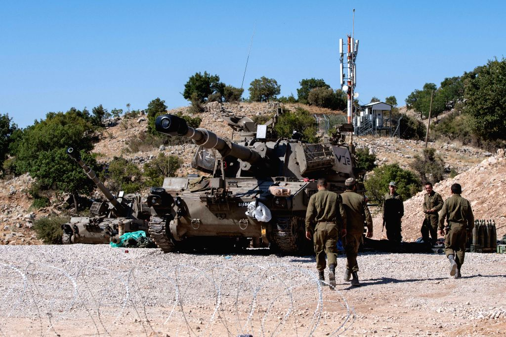 GOLAN HEIGHTS, Aug. 25, 2019 - Israeli soldiers are seen next to an armored fighting vehicle in the Israeli occupied Golan Heights, on Aug. 25, 2019. Chief of General Staff of the Israel Defense ...