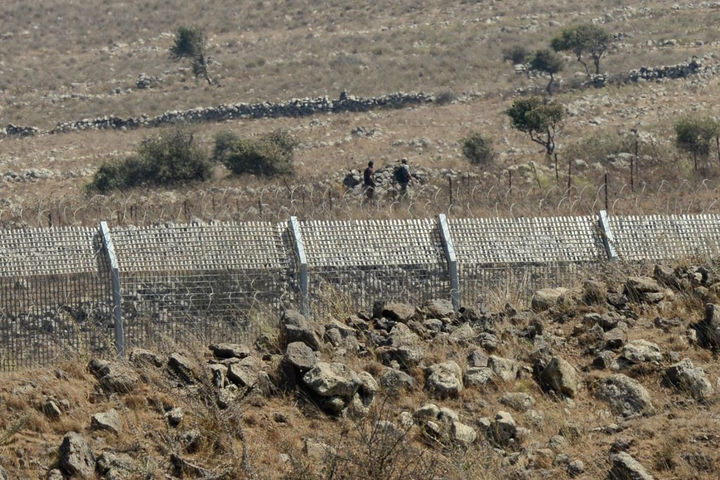 Syrian rebels are seen next to Quneitra crossing on the Golan Heights, on Aug. 28, 2014. The United Nations demanded Thursday the unconditional and immediate .