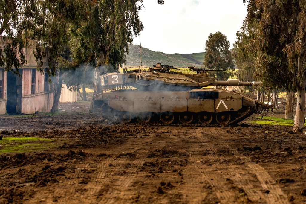GOLAN HEIGHTS, Feb. 13, 2019 - An Israeli tank takes part in a training exercise in the Israeli-occupied Golan Heights near the Syrian city of Quneitra on Feb. 12, 2019. (Xinhua/Ayal ...