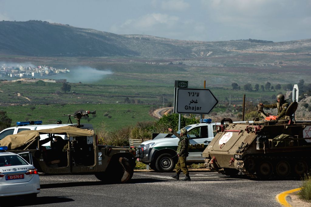 Israeli soldiers and police seal off the highway near the Israel-Lebanon border after an anti-tank missile hit an Israeli army vehicle, on Jan. 28, 2015. ...