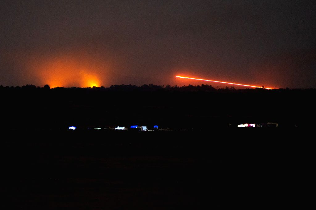 GOLAN HEIGHTS, July 24, 2018 - Photo taken on July 24, 2018 from the Israeli-occupied Golan Heights shows explosions on the Syrian side near the ceasefire line between Syria and Israel. Israel ...