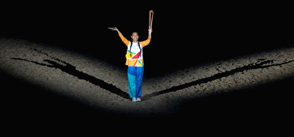 GOLD COAST, April 4, 2018 - A schoolgirl holds the Queen's Baton during the opening ceremony of the 2018 Gold Coast Commonwealth Games at the Carrara Stadium in the Gold Coast, Australia, April 4, ...