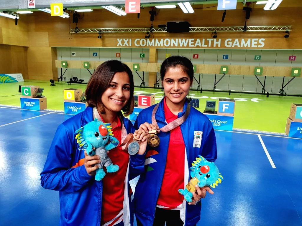Gold Coast: India's Manu Bhaker and Heena Sidhu after clinching gold and silver respectively in the Women's 10m Air Pistol event at the 21st Commonwealth Games (CWG), in Gold Coast, Australia on April 8, 2018. (Photo: IANS/Twitter/@PMOIndia)