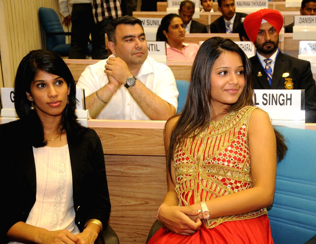 :Gold medal winners Dipika Pallikal and Joshna Chinappa at the felicitation programme of medal winners and participants of Glasgow Commonwealth Games at Vigyan Bhawan in New Delhi on Aug 8, 2014. ...