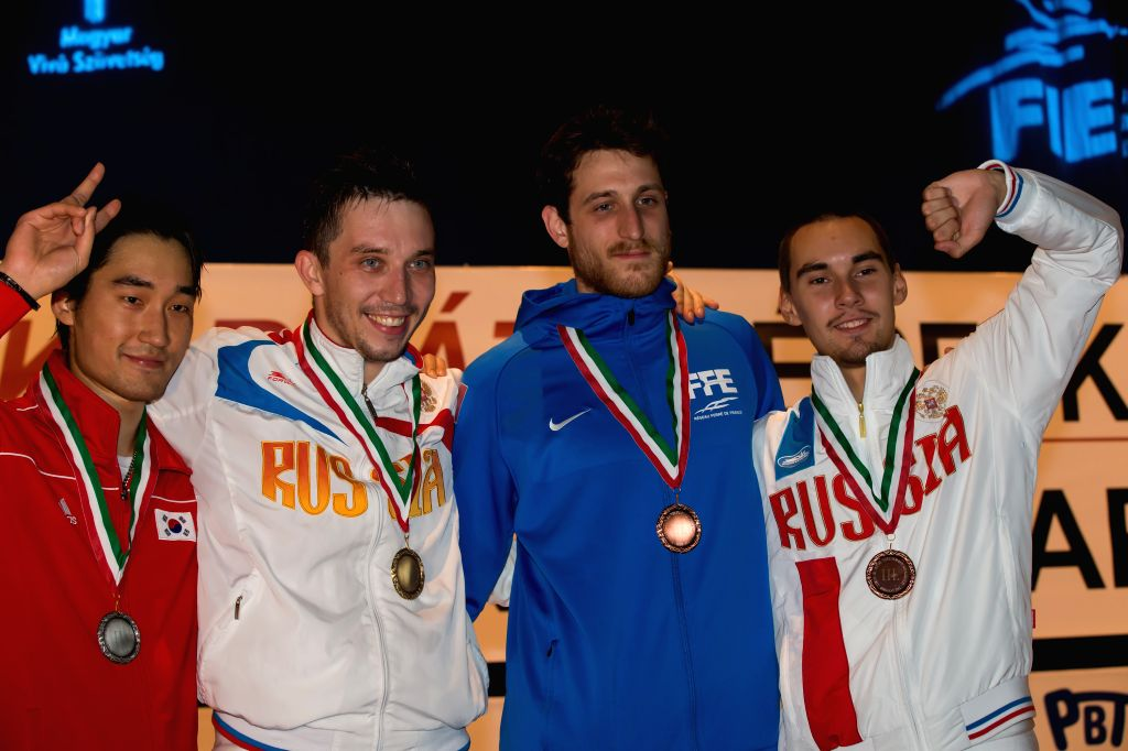 Gold medalist Alexey Yakimenko (2nd L) of Russia, silver medalist Kim Junghwan (L) of South Korea and bronze medalists Nicolas Rousset (2nd R) of France and Kamil ...