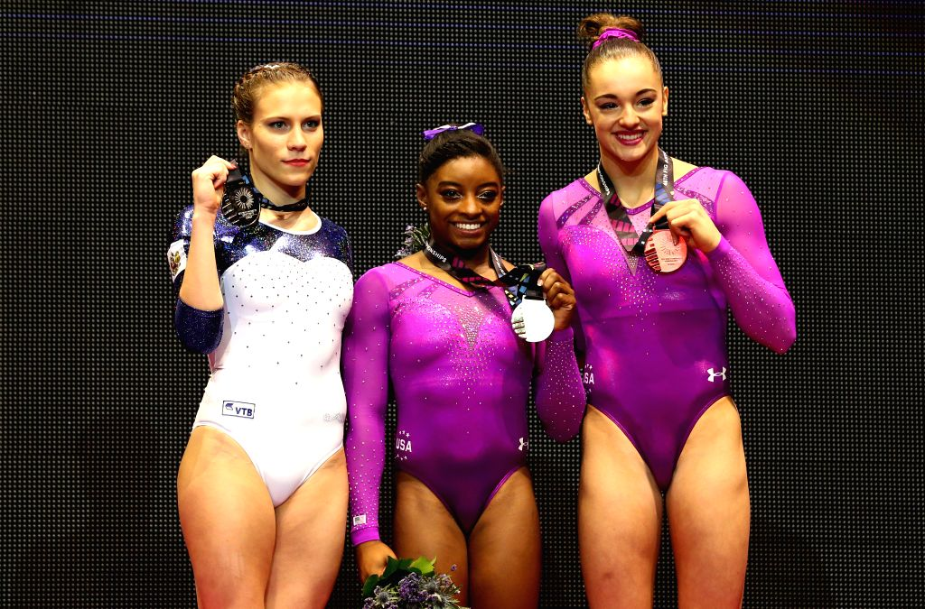 Gold medalist Simone Biles of the United States (C), silver medalist Kseniia Afanaseva (L) and bronze medalist Margaret Nichols of the United States pose during the ...