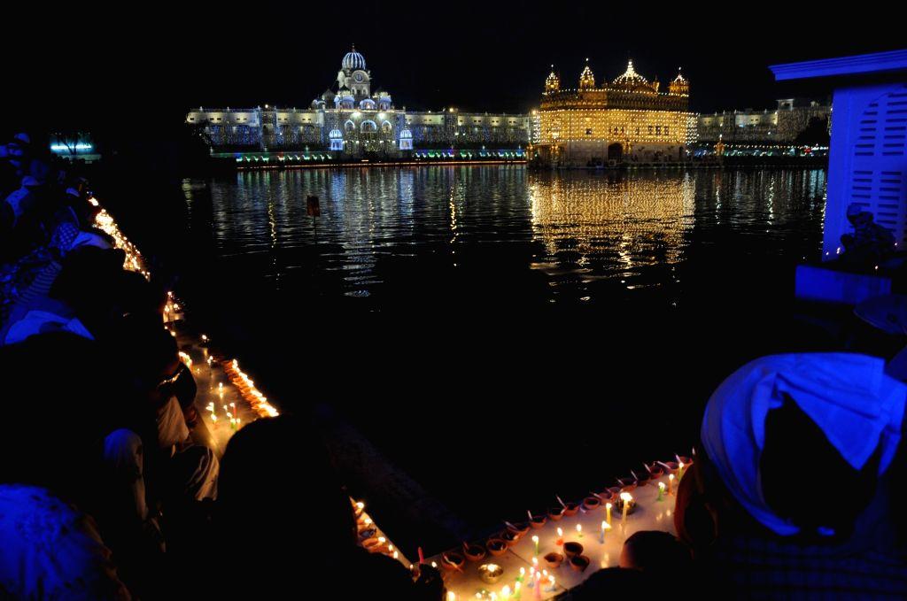 Golden Temple illuminated on the occasion of 550th birth anniversary of Guru Nanak Dev, in Amritsar on Nov 12, 2019. - Nanak Dev