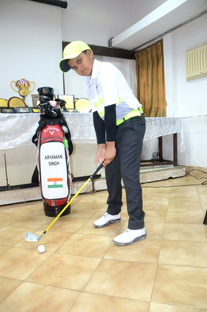 Golfer Aryaman Singh (9), who has created a new record in junior golf by winning the Indian Golf Union-West Zone Order of Merit for three consecutive years poses for a photo at Mumbai Press ... - Aryaman Singh