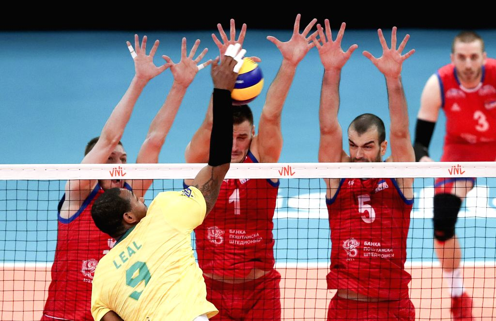 GONDOMAR, June 15, 2019 - Yoandy Leal Hidalgo (Front) of Brazil spikes during the FIVB Volleyball Nations League match between Brazil and Serbia in Gondomar, Portugal, on June 14, 2019. Serbia won ...