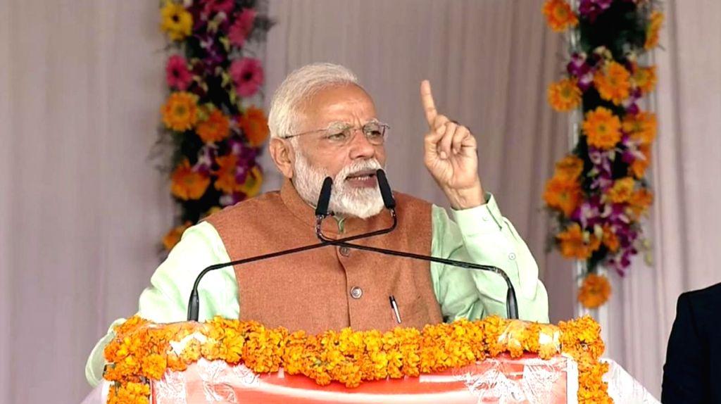 Gorakhpur: Prime Minister Narendra Modi addresses at the inauguration of the Pradhan Mantri Kisan Samman Nidhi (PM-KISAN) scheme in Haryana's Gorakhpur, on Feb 24, 2019. (Photo: IANS) - Narendra Modi