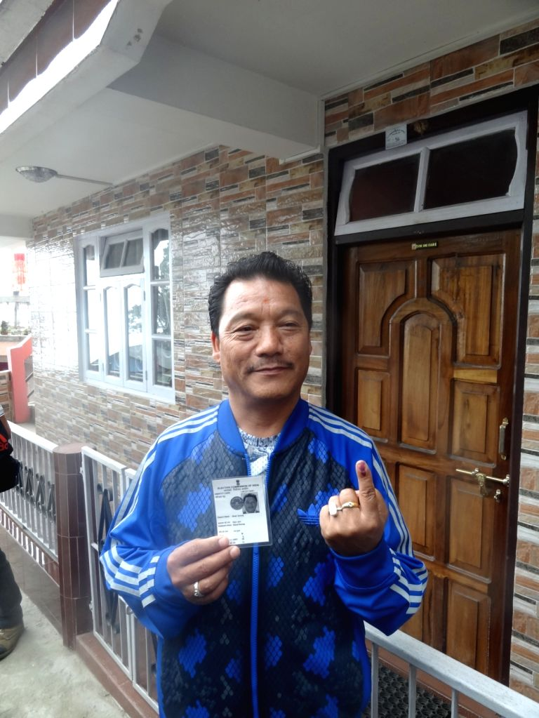 Gorkha Janmukti Morcha Bimal Gurung shows his fore finger marked with phosphorous ink after casting his votes at a polling booth during the third phase of West Bengal Legislative Assembly ...