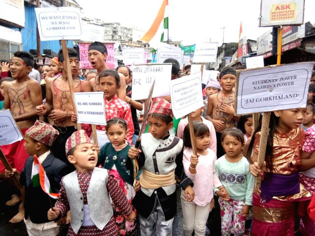 Gorkha kids participate in a pro-Gorkhaland rally organised by Gorkha Janamukti Morcha (GJM) in Darjeeling on June 28, 2017.