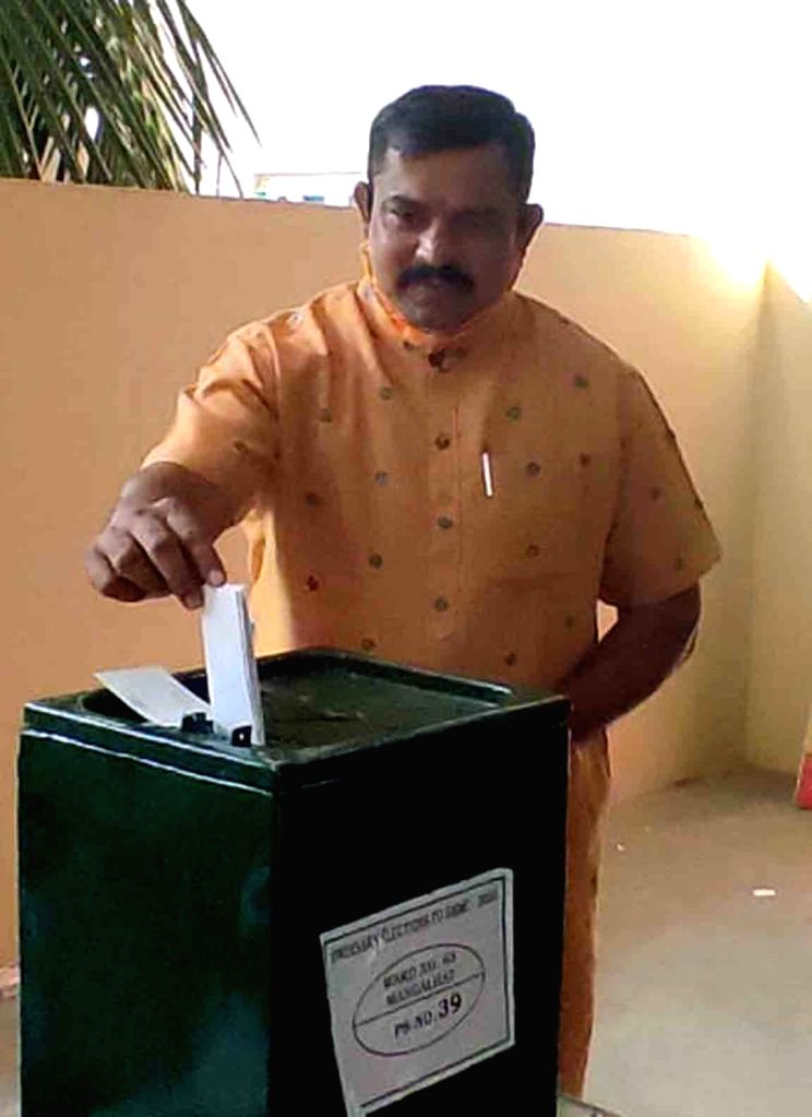 Goshamahal BJP MLA T. Raja Singh casts his ballot during voting for Greater Hyderabad Municipal Corporation (GHMC) elections, on Dec 1, 2020. - T. Raja Singh