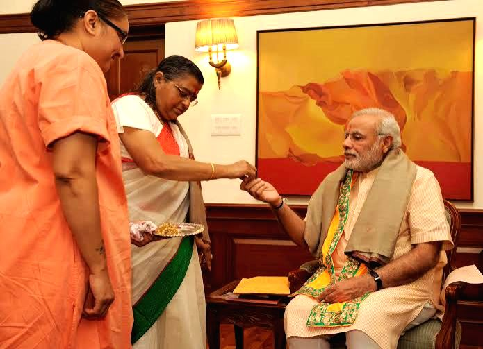 Goswami Indira Beti ji, of Vrajdham Mandir, Baroda, calls on Prime Minister Narendra Modi, in New Delhi on July 31, 2014. - Narendra Modi