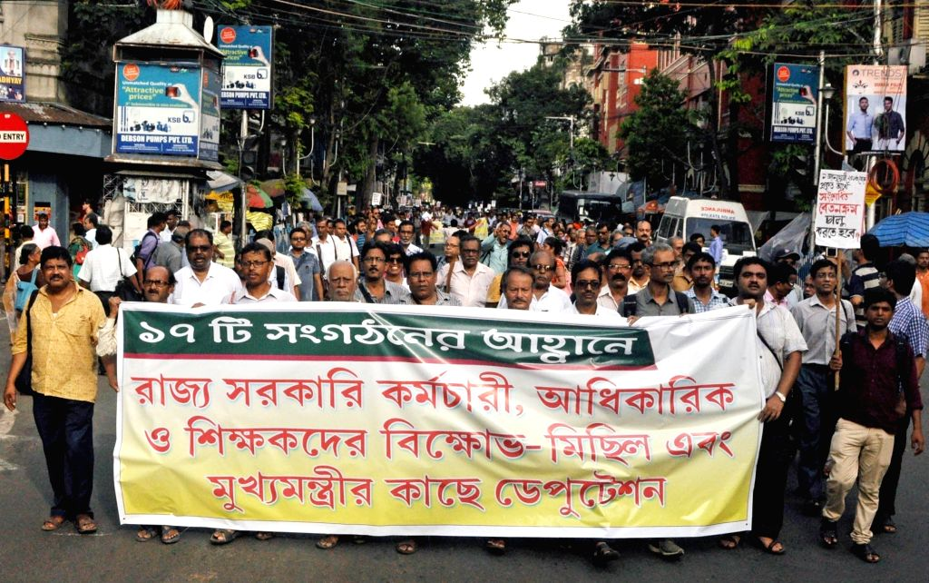 Government employees participate in a protest rally against the State Government over their various demands, in Kolkata on Sep 4, 2019.