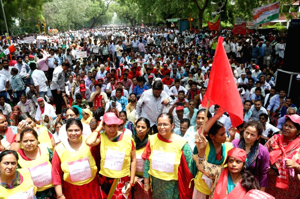 Government employees stage a demonstration to demand implementation of Seventh Pay Commission in New Delhi on June 24, 2016.