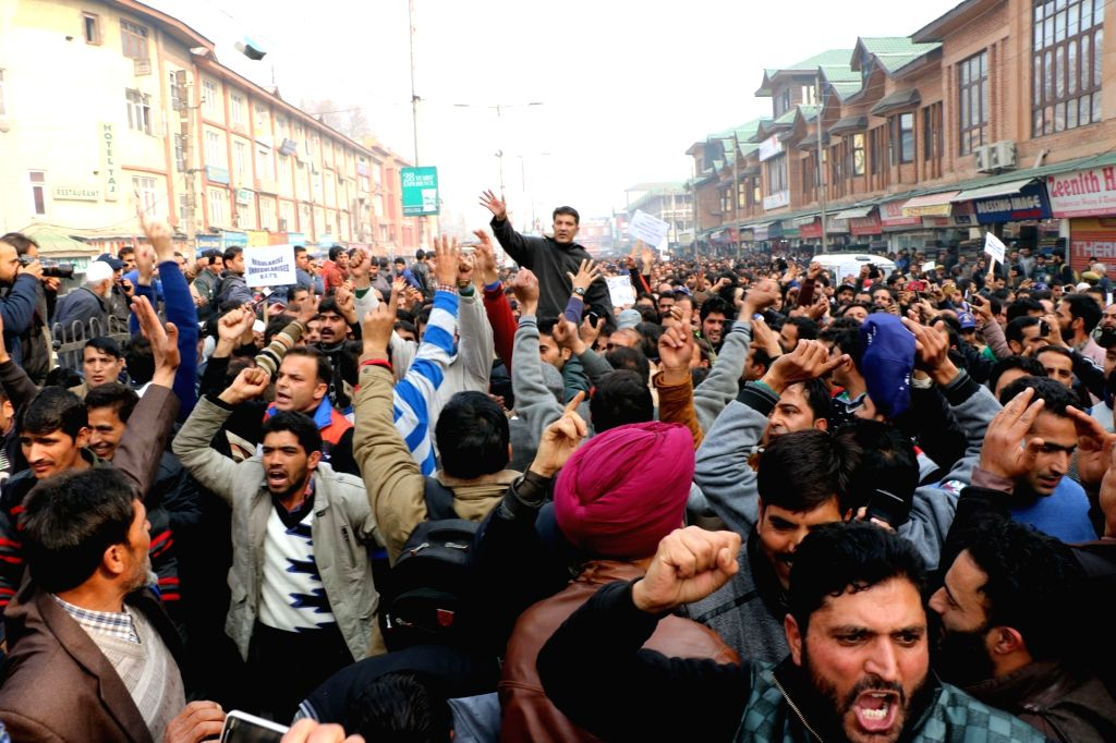 Government teachers appointed under various central government schemes during a protest march against J&K Government regarding their pending salaries in Srinagar on Nov 21, 2015.