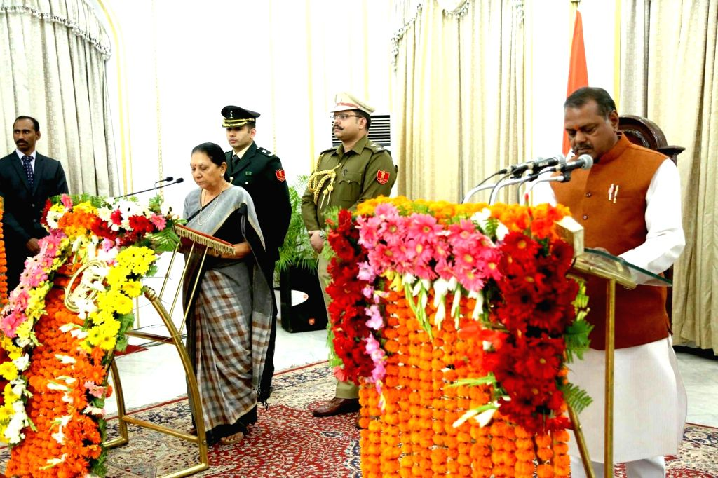 Governor Anandiben Patel administers the oath of office to Narayan Singh Kushwaha during a swearing-in ceremony in Bhopal on Feb 3, 2018. Three new Ministers were inducted into the Shivraj ... - Anandiben Patel, Narayan Singh Kushwaha, Shivraj Singh Chouhan and Jalam Singh Patel