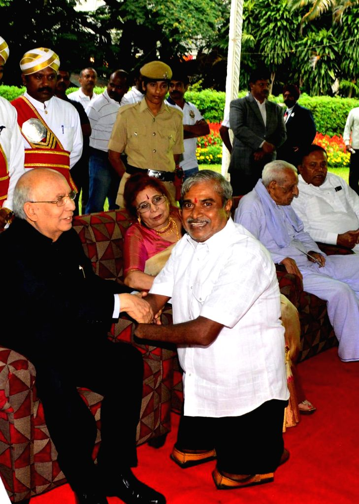 Governor HR Bharadwaj being greeted by CM Siddaramaiah during the High tea party for freedom fighters at Rajbhavan in Bangalore on August 15, 2013. (Photo::: IANS)