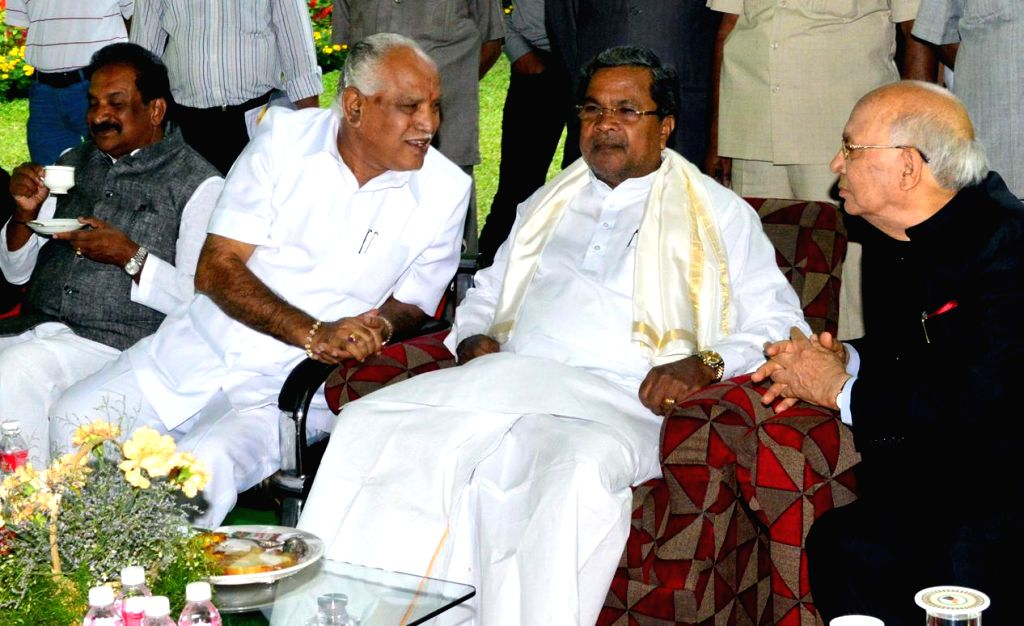 Governor HR Bharadwaj interacting with CM Siddaramaiah and Former CM BS Yeddiyurappa during the High tea party for freedom fighters at Rajbhavan in Bangalore on August 15, 2013. (Photo::: IANS)