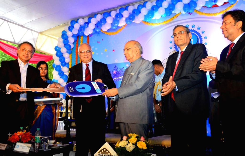 Governor HR Bharadwaj presenting bus key to Agastya International foundation during the celebration of Three Decades of Bangalore Circle Formation of State Bank of India with Ashwin Mehra, ...