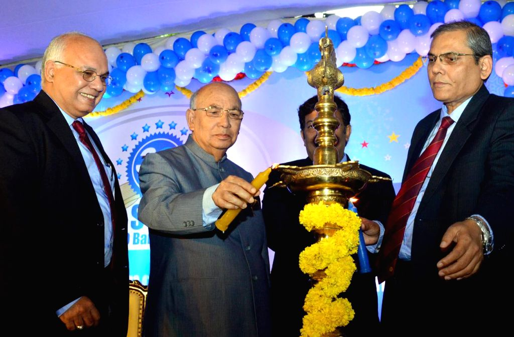 Governor HR Bharadwaj with Ashwin Mehra, Chief General Manager , SBI during the celebration of Three Decades of Bangalore Circle Formation of State Bank of India in Bengaluru on August 16, 2013. ...