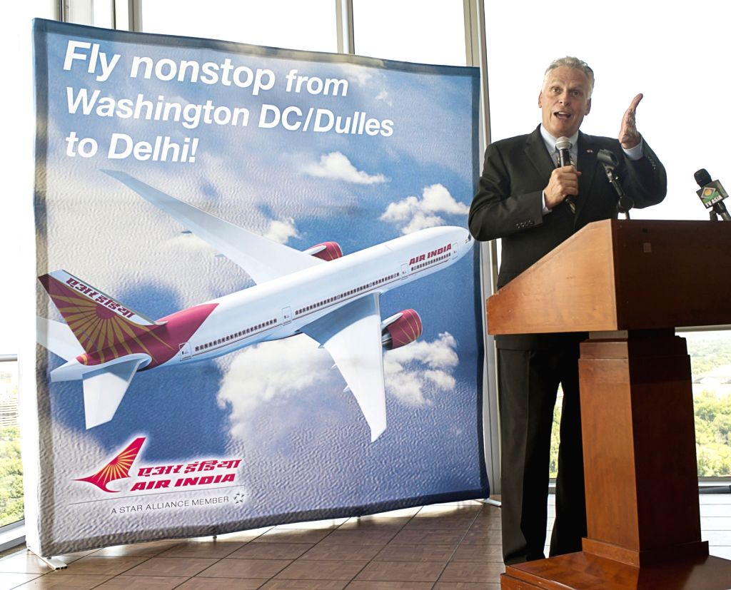 Governor of Virginia Terry McAuliffe addresses during a programme organised to welcome Air India's Non Stop flight from Delhi at Washington Dulles International Airport in Virginia on July ...
