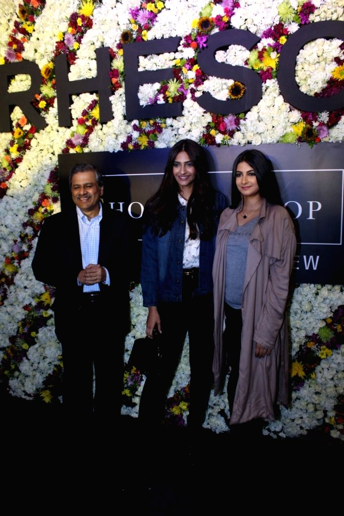 Govind Shrikhande, MD Shoppers Stop with actress Sonam Kapoor with her sister and filmmaker Rhea Kapoor during the launch of Rheason, a clothing brand in Mumbai on May 12, 2017. - Sonam Kapoor