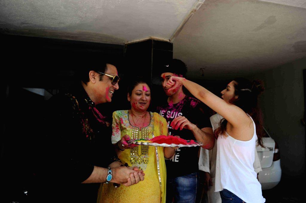 Govinda celebrates Holi with his family.