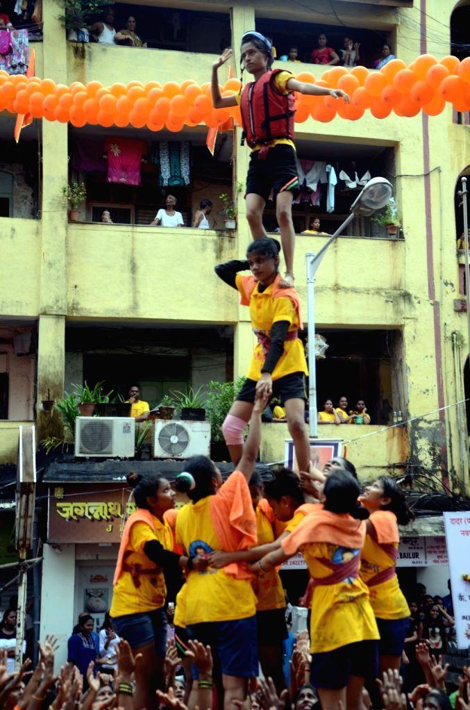 Govindas participate in Dahi-Handi festival in Mumbai on Aug 15, 2017.