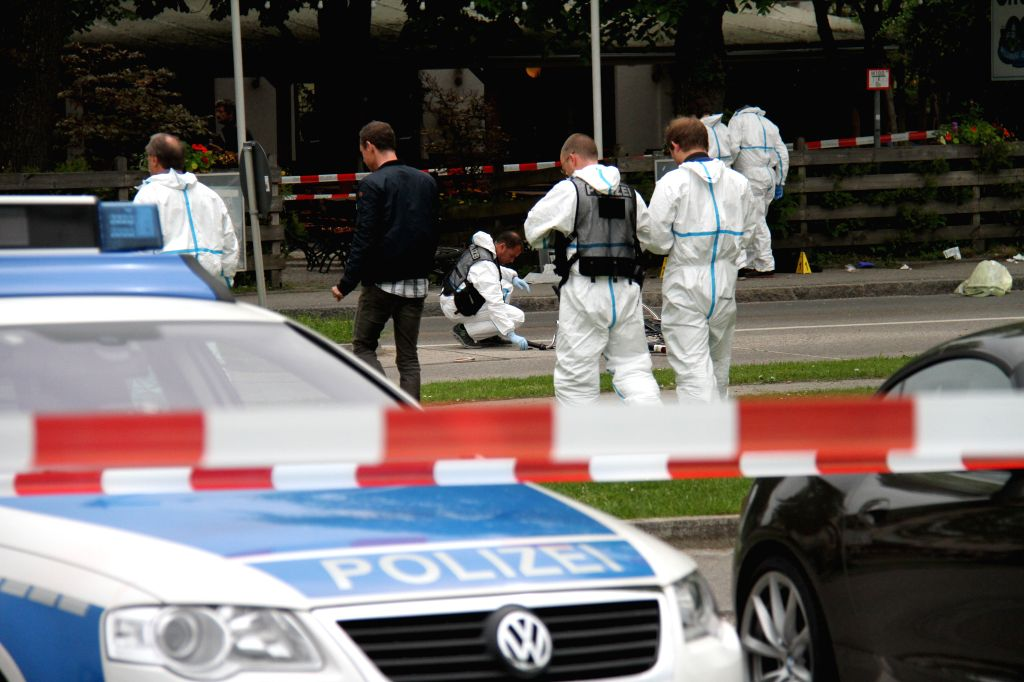 GRAFING, May 10, 2016 - Policemen launch a criminal investigation at the Grafing train station in southern German city of Grafing, on May 10, 2016. A young man stabbed people indiscriminately and ...