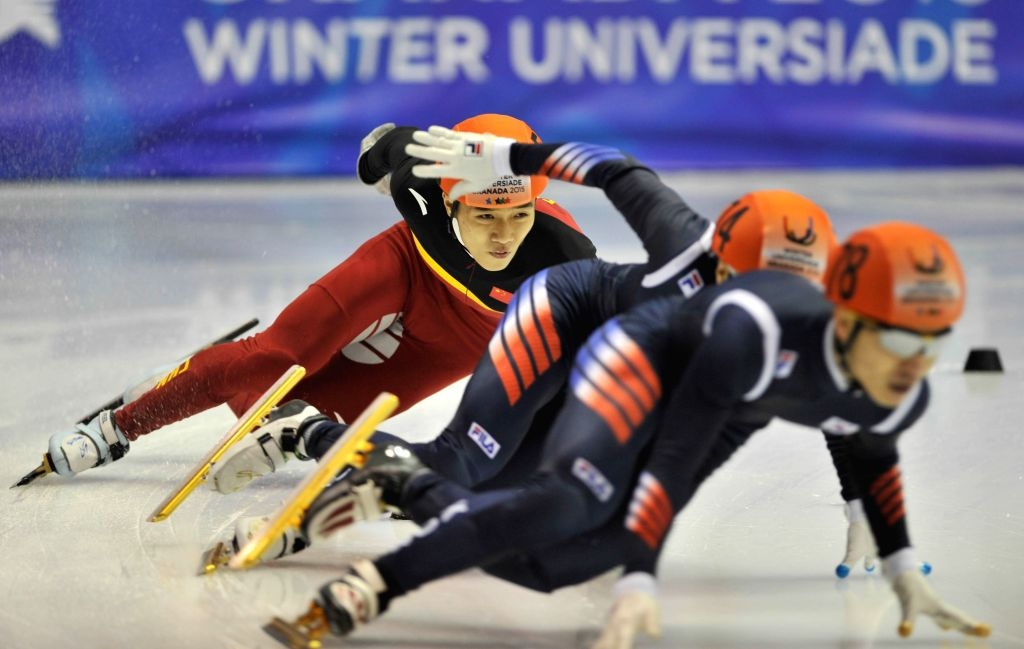 China's Chen Guang (1st R) competes during the men's 500m short track final at the 27th World Winter Universiade in Granada, Spain, Feb. 11, 2015. Chen got the ...
