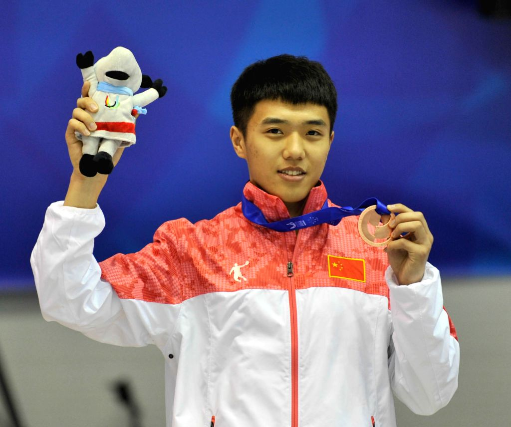 China's Chen Guang attends the awarding ceremony for the men's 500m short track event at the 27th World Winter Universiade in Granada, Spain, Feb. 12, 2015. Chen ...