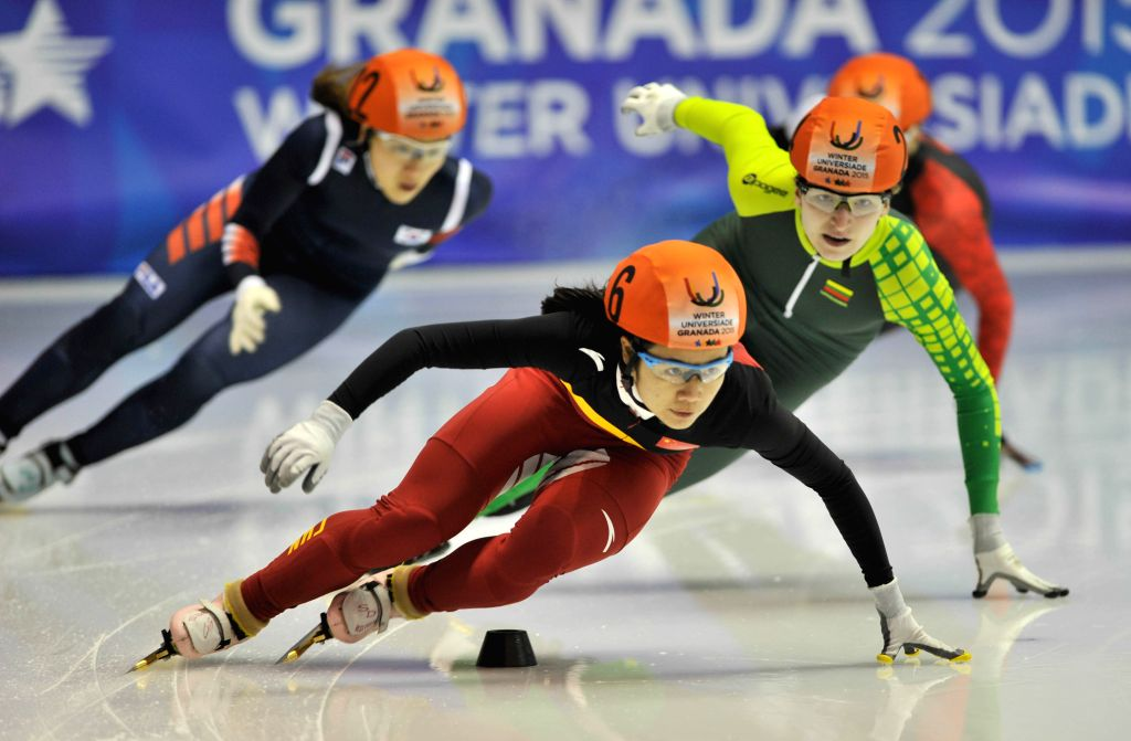 China's Han Yutong (Front) competes during the ladies' 500m short track final at the 27th World Winter Universiade in Granada, Spain, Feb. 12, 2015. Han claimed the