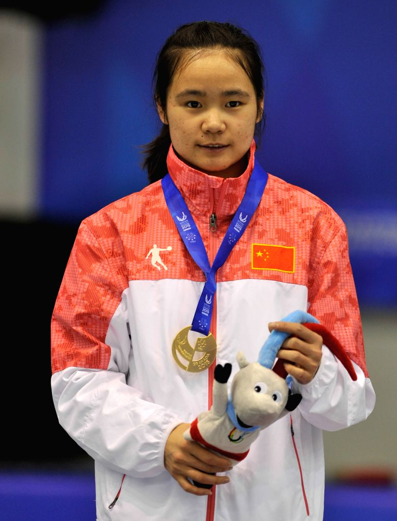 China's Han Yutong attends the awarding ceremony for the ladies' 500m short track event at the 27th World Winter Universiade in Granada, Spain, Feb. 12, 2015. Han ..