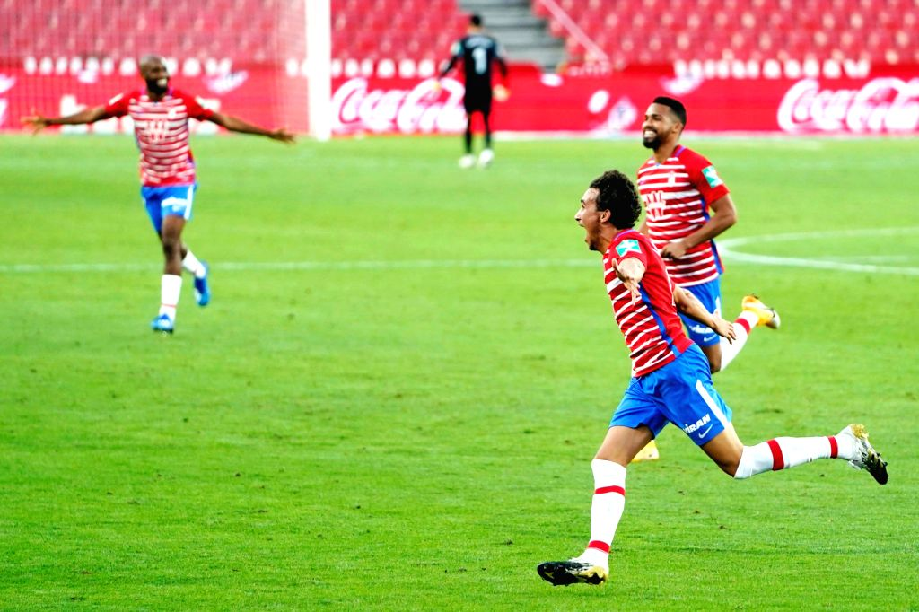 Granada's Luis Milla (2nd R) celebrates a goal during a Spanish La Liga league match between Granada CF and Athletic Club Bilbao in Granada, Spain, Sept. 12, 2020.
