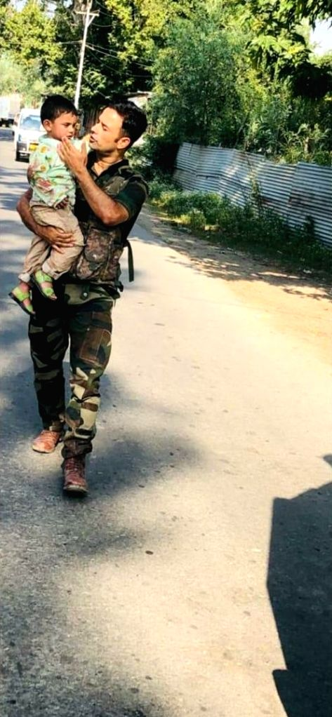 Grandfather killed by terrorists while attacking our Naka party at Sopore. Grandchild rescued from site. See the painful picture where grandpa is dead and the child innocently sitting on his body.