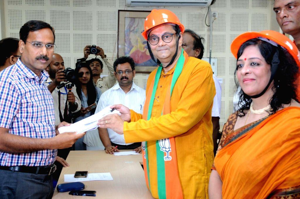 Grandnephew of Subhash Chandra Bose and BJP's Lok Sabha candidate from Kolkata South, Chandra Kumar Bose files his nomination for the forthcoming Lok Sabha elections, in Kolkata on April 24, ... - Subhash Chandra Bose and Chandra Kumar Bose